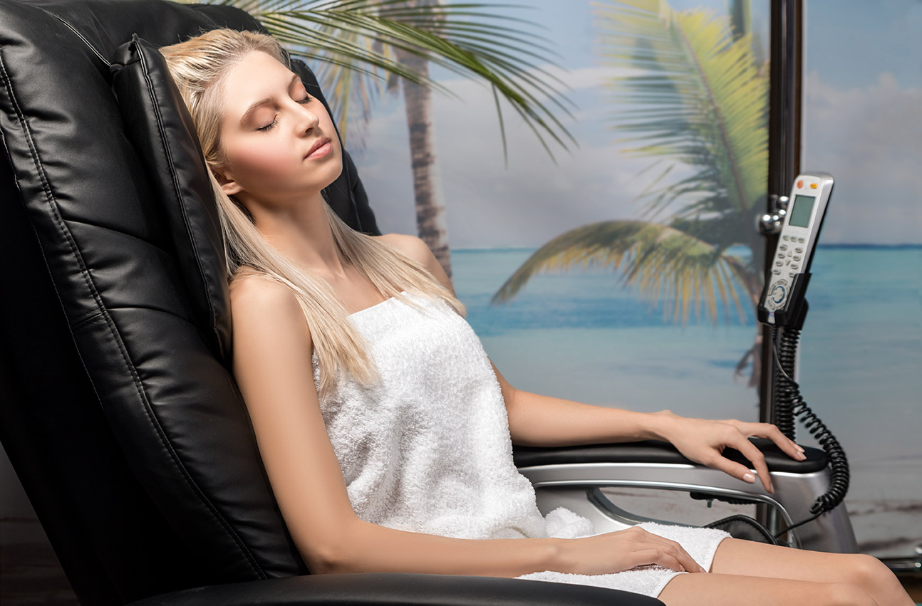 young lady relaxing in the massage chair.